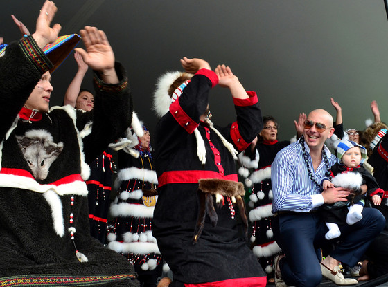 Alutiiq dancers perform for Pitbull during his visit to Kodiak, Alaska. (AP Photo/James Brooks, Kodiak Daily Mirror)