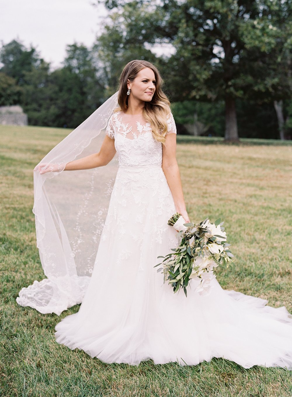 Caroline and Derek's wedding was planned and designed by Big Events Wedding in Nashville, TN. The beautiful bride is pictured on her wedding day.