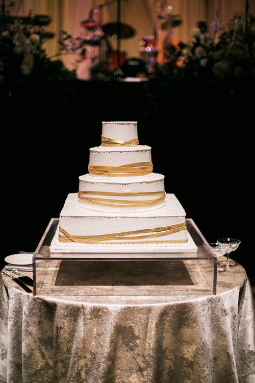 The Brown's gorgeous wedding cake awaits cutting at their elegant wedding reception at Schermerhorn Symphony Center in Nashville, TN. Wedding planning & design by Big Events Wedding.