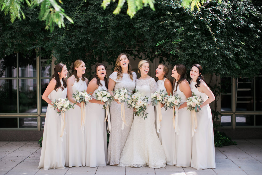 The bride posing with her bridesmaids before the Schermerhorn wedding reception. Wedding planned & designed by Big Events Wedding.