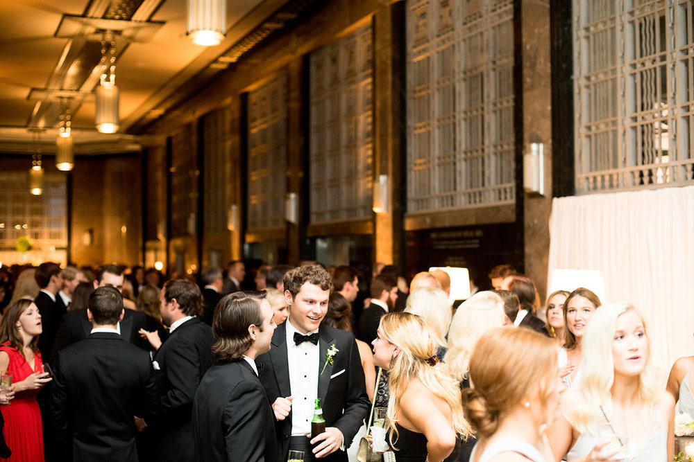 Guests celebrate at the Gilbert Wedding Reception at the Frist Center for the Visual Arts in Nashville, TN. Wedding planning & design by Big Events Wedding.