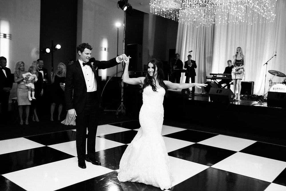 The bride & groom share their first dance shortly after getting married at the Frist Center for the Visual Arts in Nashville, TN. Wedding planning & design by Big Events Wedding.