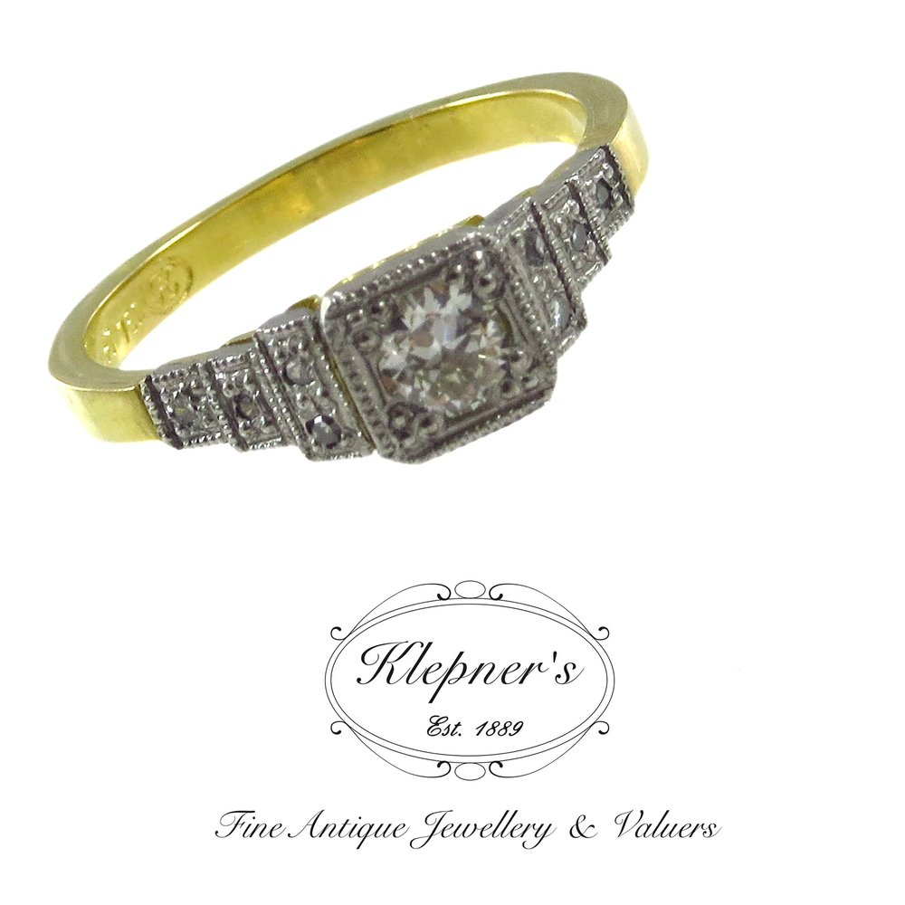 Platinum and 18ct yellow gold Art Deco inspired ring, custom made using clients diamonds.
