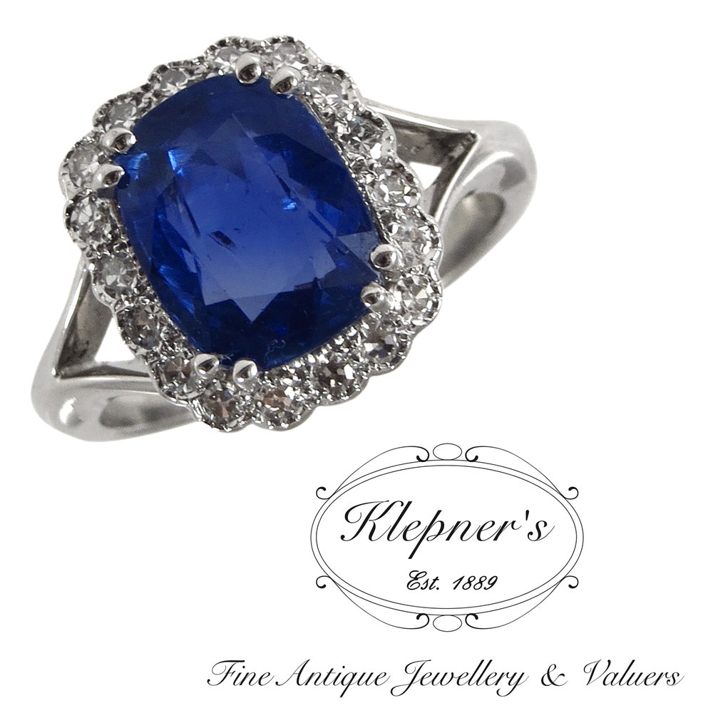 Sapphire & diamond cluster ring, using our clients natural blue sapphire.