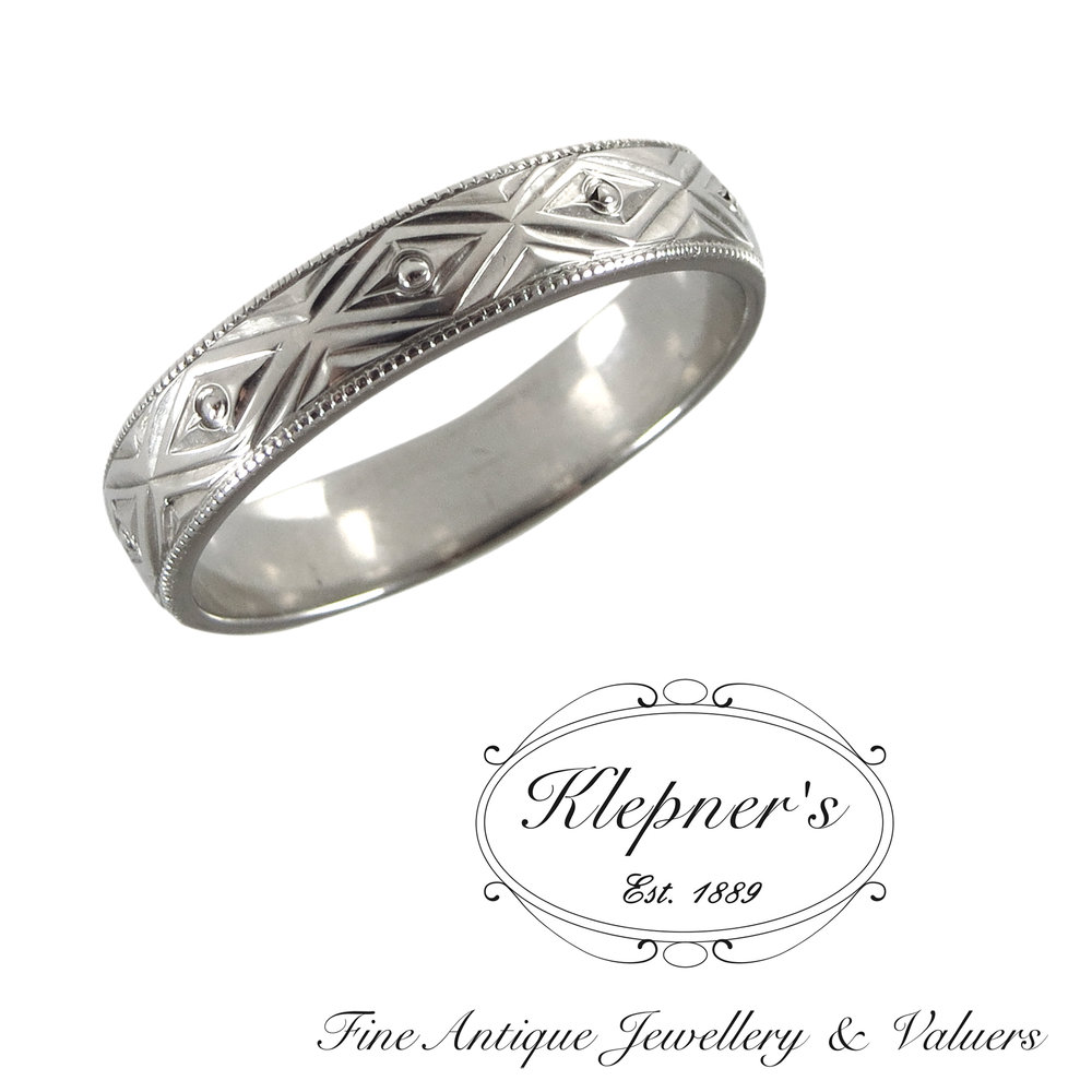 Engraved gents Art Deco inspired geometric wedding band