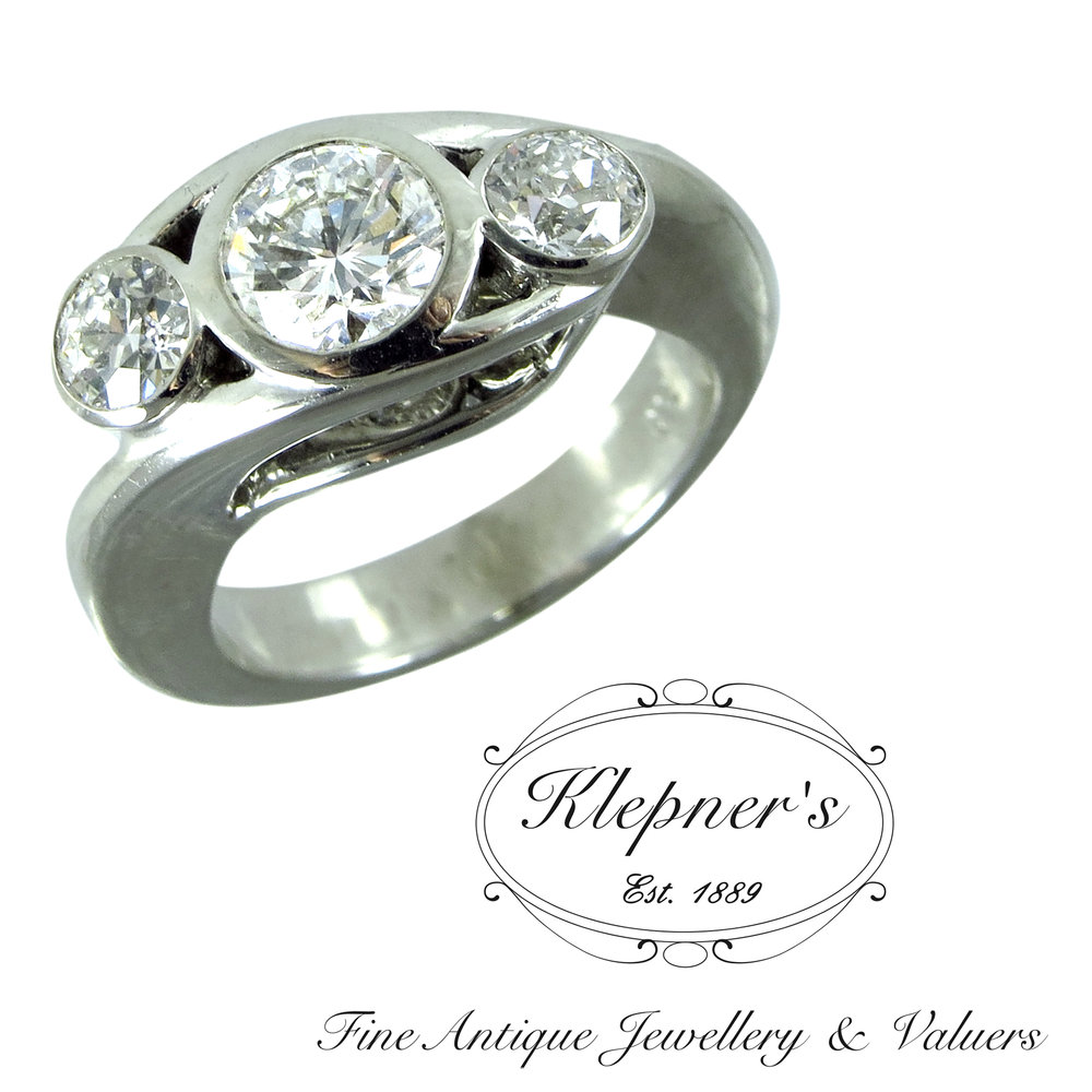 18ct white gold Modern three stone diamond ring, using clients diamonds.