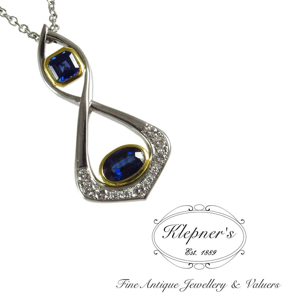 Modern sapphire & diamond pendant.