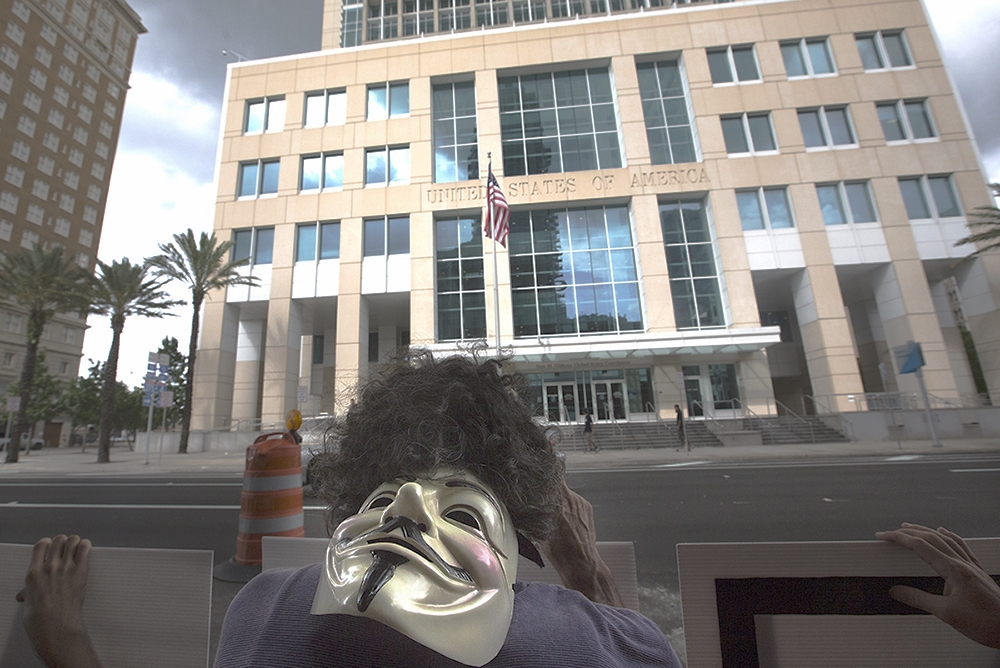 After the disclosure by ex National Security Agency employee  Edward Snowden that the agency had been using internet and cellular phone technology to spy on U.S. citizens several organizations gathered on Friday June 23, 2013 to protest across the street from the Federal Building in Downtown Tampa, Fl. The Guy Fawkes mask on the back of the head of an Occupy Tampa member has become a symbol of protest world wide. Demonstrators rallied against the NSA, advocated for the release of Bradley Manning who was arrested in 2010 for releasing classified information to the website Wikileaks, and held Snowden out as a hero.
