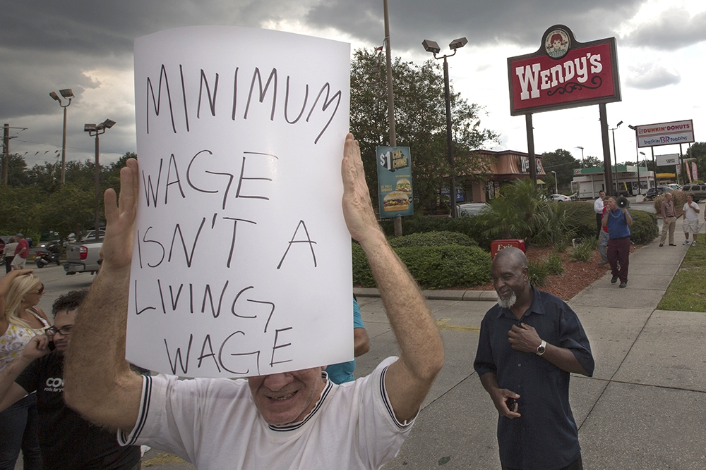 Tom Filbert who is currently unemployed demonstrates for higher wages for fast food workers during the nationwide fast food workers strike