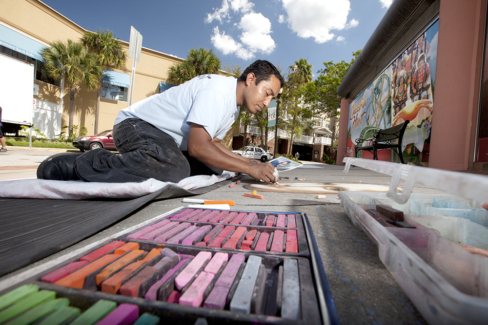 Brendy Gutierrez of West Palm Beach chalks a tribute to Leonardo da Vinci. This was Gutierrez's first appearance at Tampa's Chalk Walk published March 16, 2012