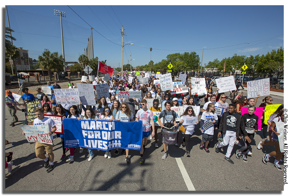 Thousands march down Cass Street following a rally at Kiley Garden in downtown Tampa. The march ended back at the garden around 12:00 p.m.