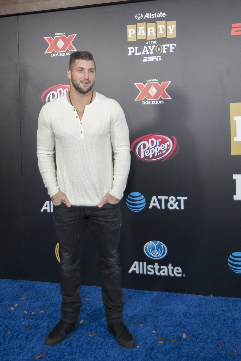 Tim Tebow, former professional American football player poses on the carpet.jpg