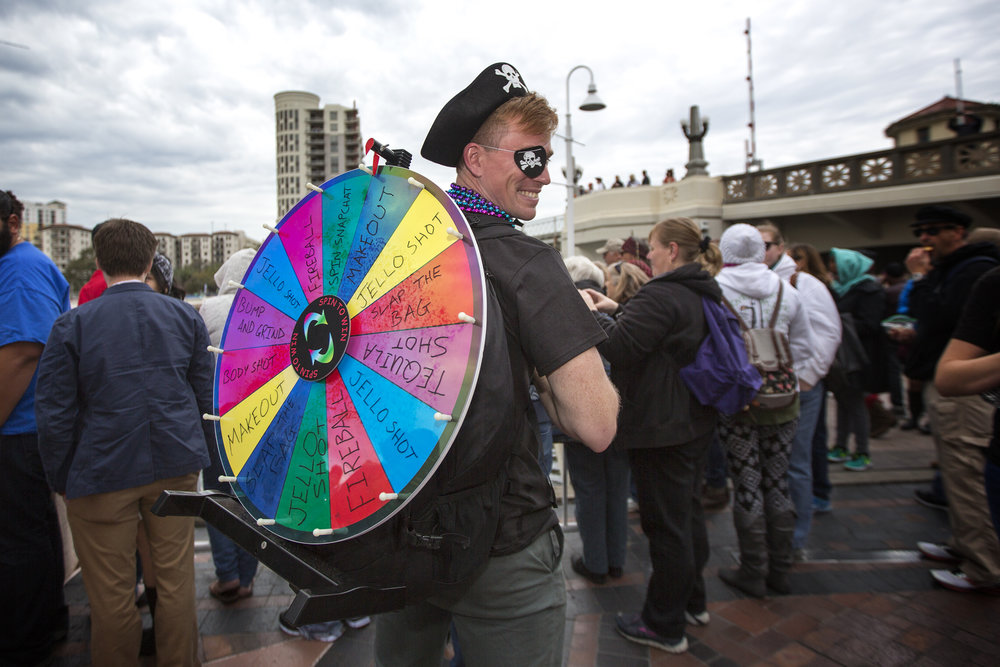 Loring Ross from Fort Walton Beach brings his own version of the wheel of fortune to the parade.jpg
