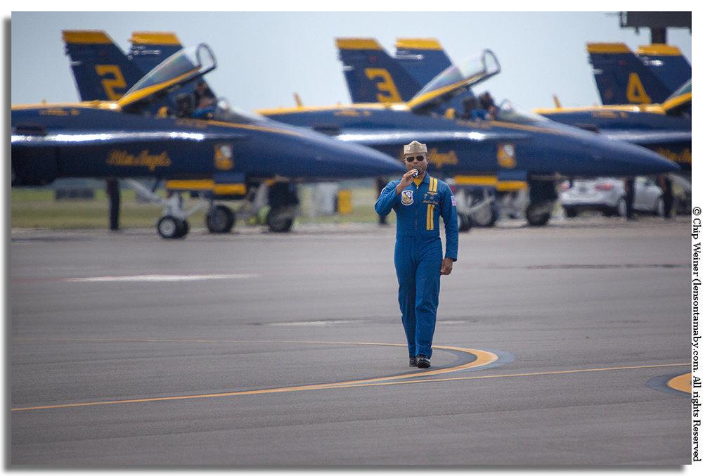 Navy Lt. Andre Webb, pilot number 7, announces for the Blue Angels