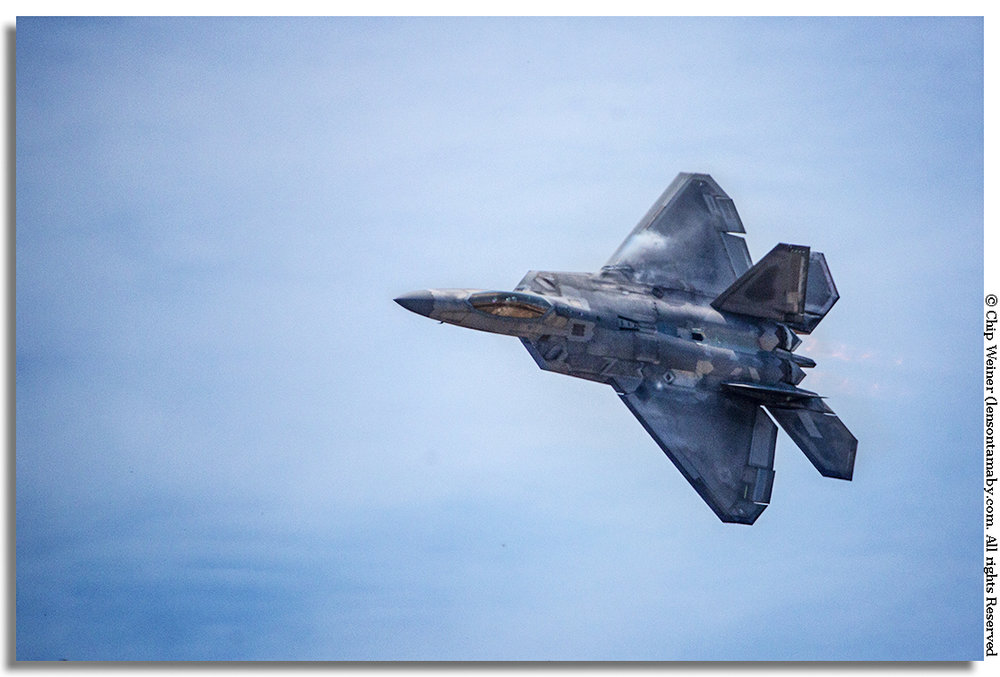 This F-22 Raptor gets put through it's paces as it thunders through the skies over Tampa