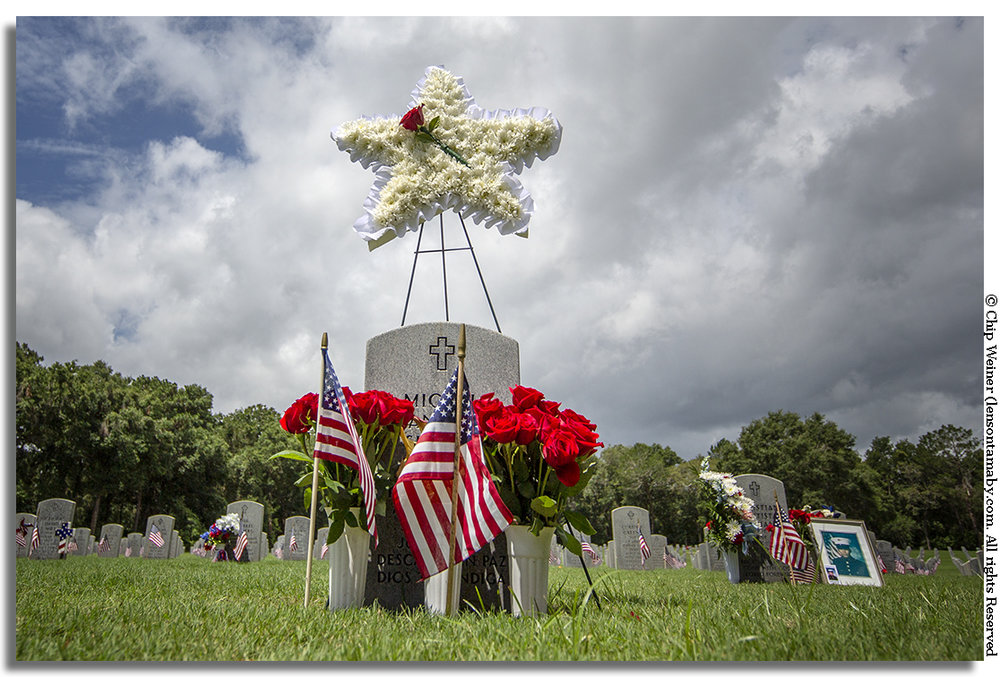 Stars and stripes decorate this soldiers grave