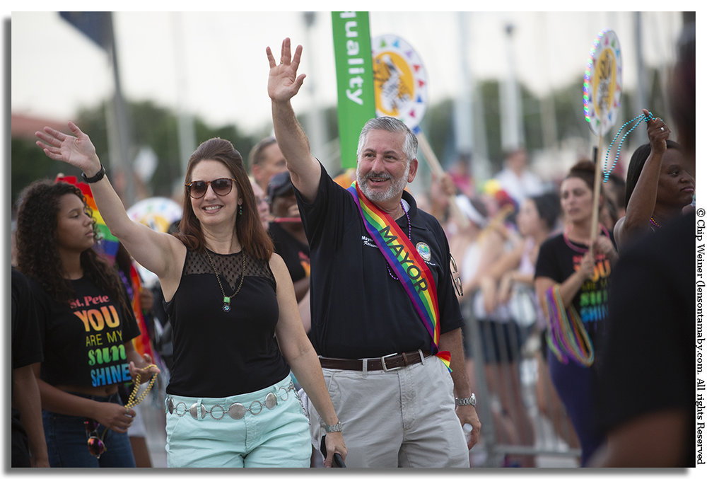 St Petersburg Mayor Rick Kriseman with his wife Kerry Kriseman march down Beach Drive. The pair, along with Congressman Charlie Crist made two appearances on Saturday.  Once in front of the TransMarch and again in the main parade
