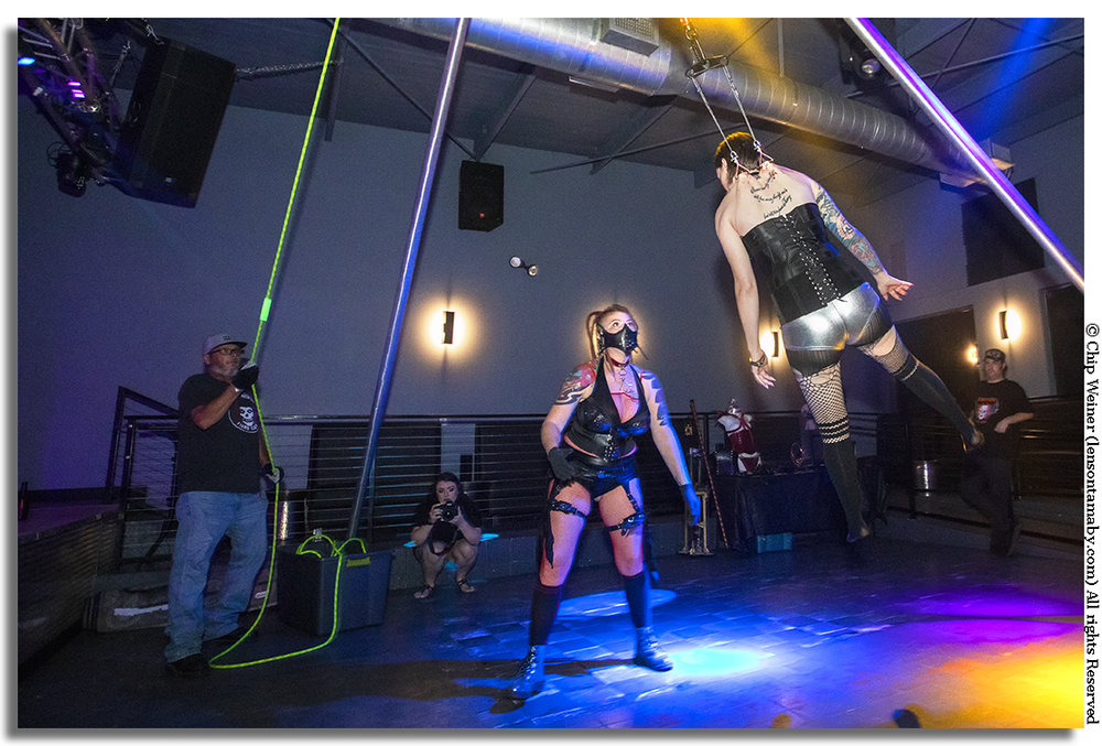 A first timer gives body suspension a try at the Pegasus Nightclub for the Suspension and Carnival show