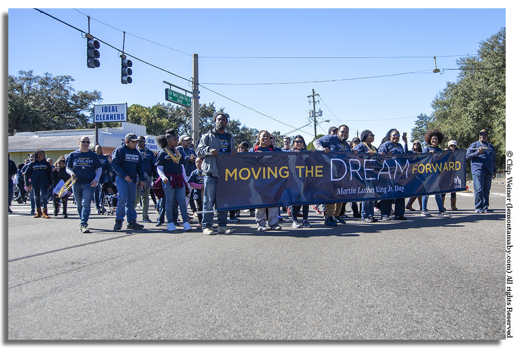The spirit of the day is captured by this large group promoting the message of Dr. Martin Luther King Jr.