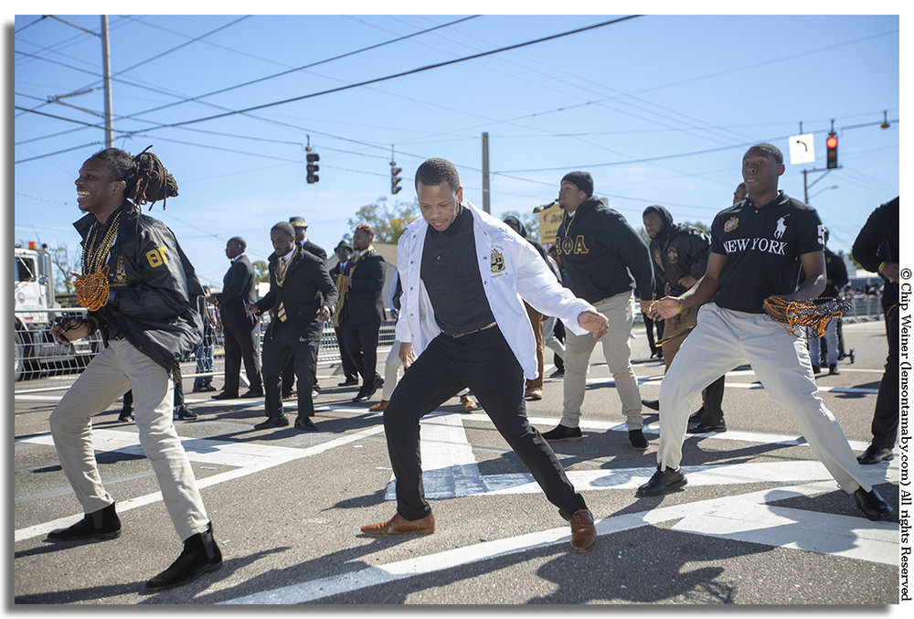Members of the Alpha Phi Alpha fraternity step during the 2019 Martin Luther King Parade in Tampa. Members from several chapters are present