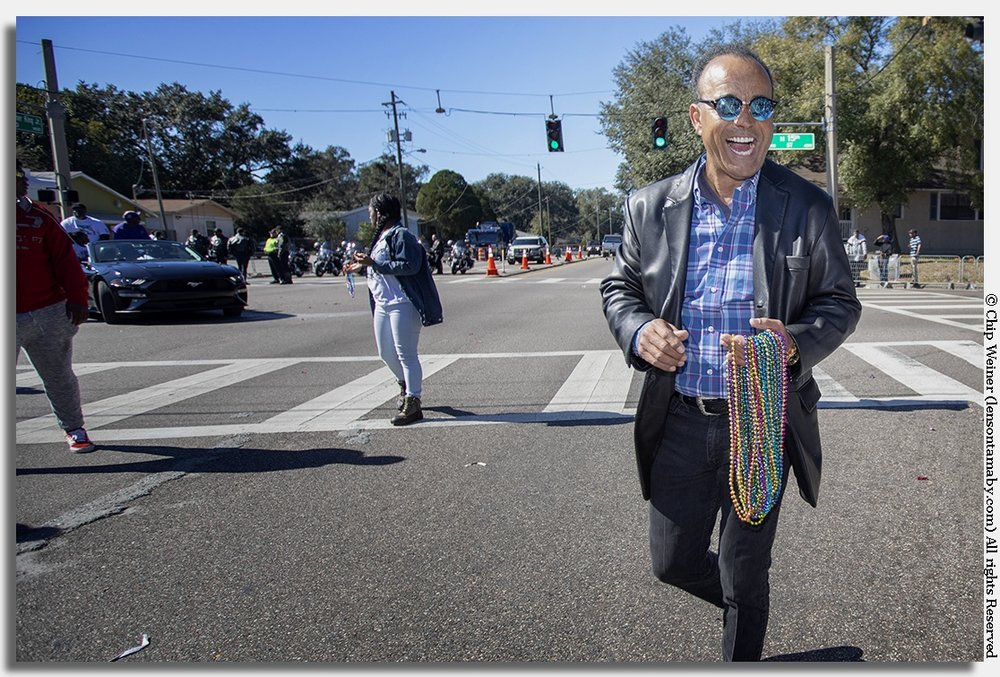Reginald Roundtree, WTSP news anchor, smiling big at the Tampa MLK parade