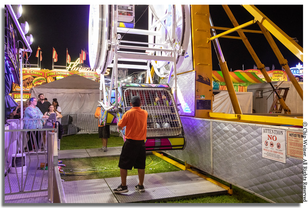 Claustrophobia has no place here on The Zipper. Ticket holders are placed in seats behind a large padded cage door that locks them in.