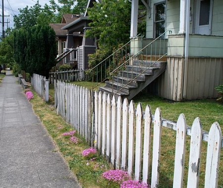 A poorly maintained wooden fence creates a bad first impression