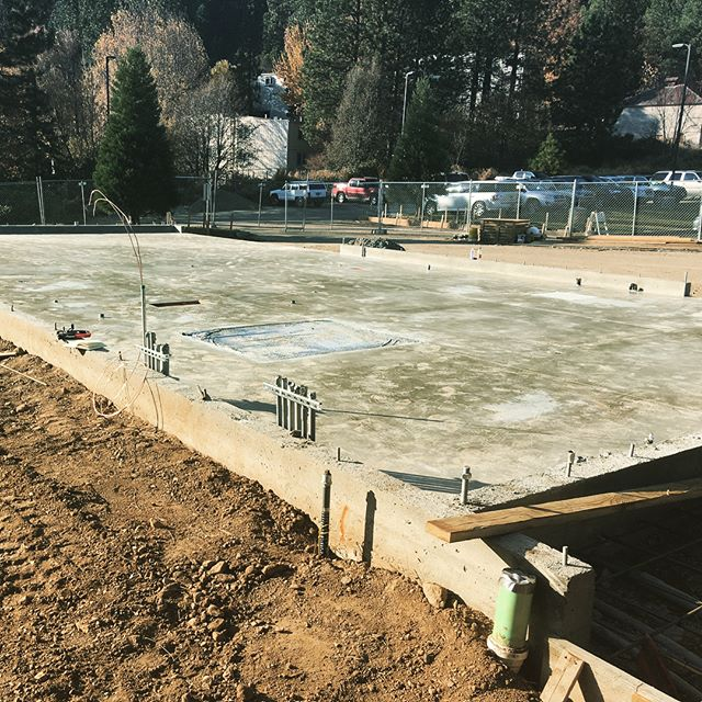 The slab is poured for California's first full cross-laminated timber (CLT) building, a collaboration between our subsidiary High Sierra, @sierra.institute, and #plumascounty. Besides being a win for #masstimber, the facility will house a #hogfuel boiler to create #biomassheat, plus an organic rankine cycle (ORC) system to generate electricity on site. Buried PEX piping will distribute heat to the adjacent building. #biomassdoneright #communityenergy #crosslaminatedtimber