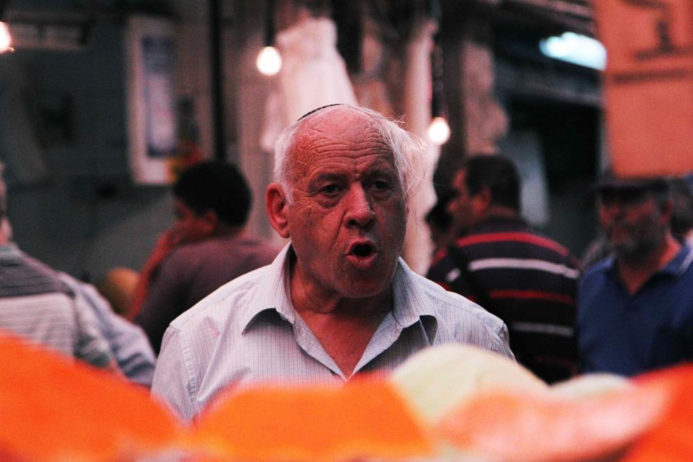 Man shouting in market.jpg