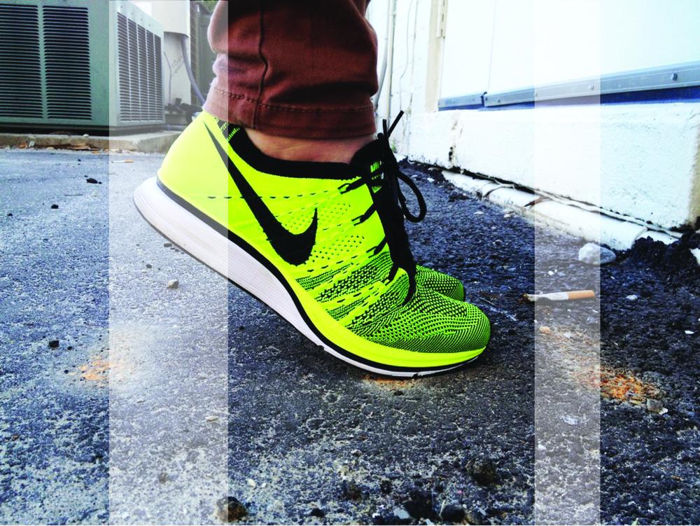 Nike Flyknit Racer in VOLT