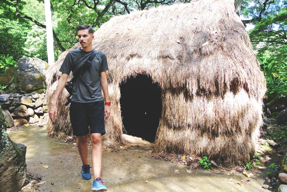 P visiting a thatch hut ...