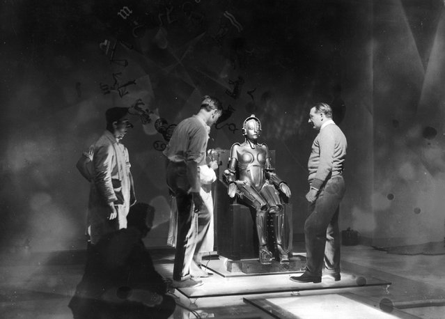Lang (right) checks preparations for an upcoming scene.  Metropolis, 1927.