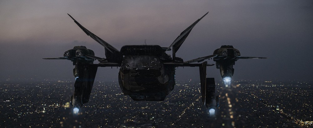 The Raven searches over the city of Los Angeles at night.