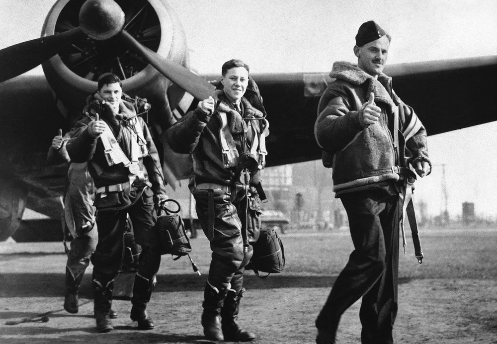 Members of a British Royal Air Force bombing squadron hold thumbs up on April 22, 1940, as they return to home base from an attack on German warships off Bergen, Norway. (AP Photo)