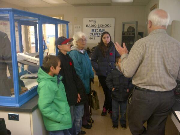 Hilda is surrounded by her family, attentively listening to one of our volunteers talking about wavelengths.