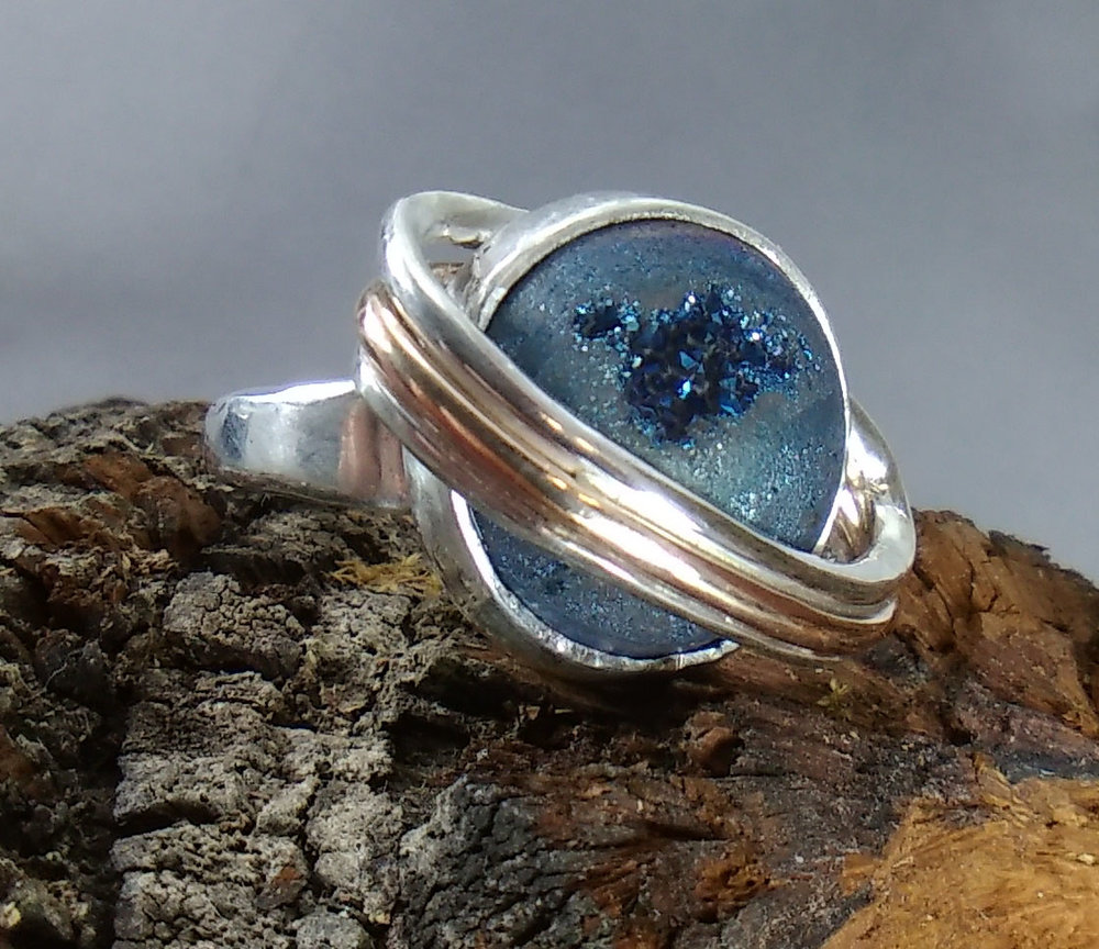 Student-made engagement ring made for his girlfriend; a lover of science.