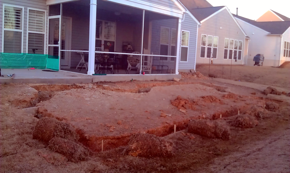 Excavation is underway! Not exactly a pretty site, but you can see the design starting to take shape.
