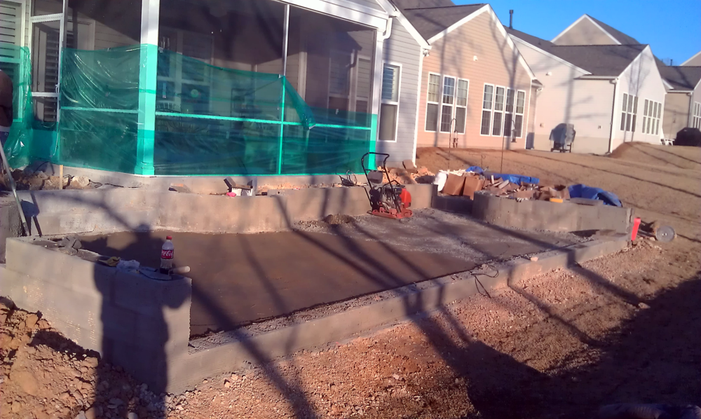 The concrete has just been poured and is left to set up. This solid foundation is critical for the stone and pavers to last a lifetime without uneven settling or leaning.