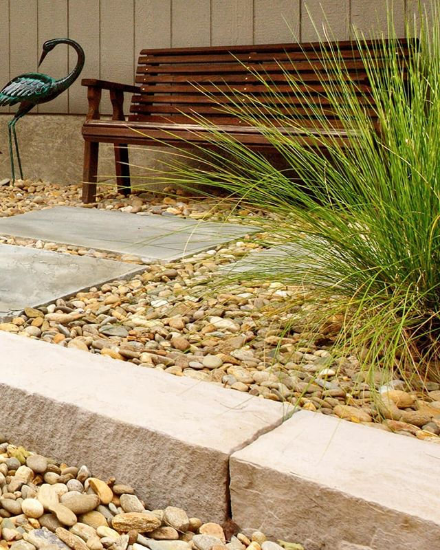 A close up of the xeriscape we've been featuring. This pic really shows off the Techobloc Rocka in Rock Garden Brown color. These synthetic stone slabs look great with the natural stone elements, and are serving two purposes here; first as a step, and second extending out as a low retaining wall for the minimal grade change. . . Designed and installed by the Outdoor Artisan team. Photo by @brucesaundersphotography . . . . #brucesaundersphotography #outdoorartisan #xeriscape #xeriscapes #techobloc #hardscapes #hardscaping #hardscape #decorativegravel #flagstone #stonepath #retainingwall #rockgarden #rockgardens #zengardens #retainingwalls #outdoorspace #outdoorspaces #marvinnc #outdoorlivingspace #outdoordecor #courtyard #courtyards #stonestep #rivergravel #landscapedesign #zengarden #hardscapers #zeroscape #zeroscapes