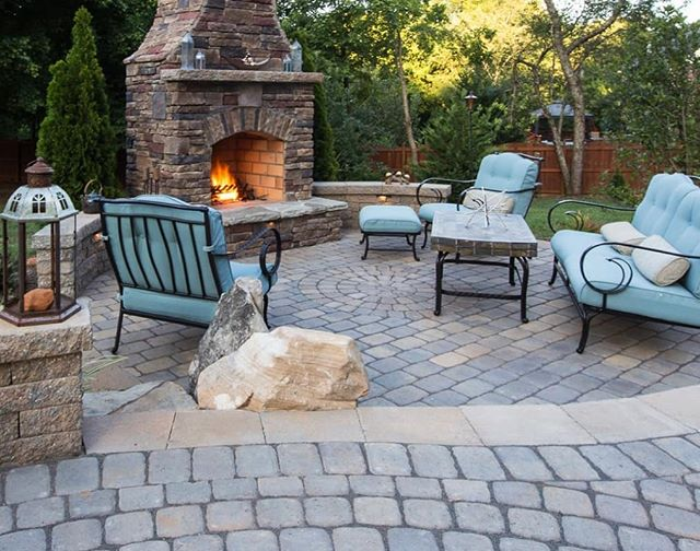 Wanted to warm up this cold Wednesday morning with a cozy fireplace photo of an outdoor space we completed three years ago. . . Designed and built by the @outdoorartisan team. Photo by @brucesaundersphotography . . . . #brucesaundersphotography #outdoorartisan #belgard #belgardoutdoorliving #charlottehomes #concordnc #outdoorlivingspace #outdoorliving #outdoorentertaining #outdoorspaces #outdoorspace #outdoorroom #patiogoals #outdoordecor #backyarddesign #backyardideas #backyards #backyardgoals #outdoorfireplaces #outdoorfireplace #stonefireplace #patiodesign #patios #patiolife #hardscapes #hardscaping #hardscape #homeandgarden #paverpatio #outdoordesign