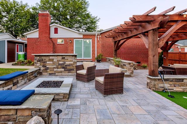 A new project photo! This complete outdoor living space includes a grill bar, putters green, pergola seating area, firepit and more you can't see here. Designed by Josh Smith, a talented landscape designer, and our most recent hire. Installed by the @outdoorartisan team. Photo by @brucesaundersphotography. . . . #brucesaundersphotography #outdoorartisan #charlottehomes #techobloc #patios #patio #backyardgoals #outdoorspaces #outdoorroom #pergola #pergolas #hardscapes #hardscape #backyarddesign #backyardideas #backyards #firepit #firepits #stonewall #seatwall #grillbar #outdoorlivingspace #outdoorspace #outdoordesign #backyardliving #outdoorentertaining #patiodesign #paverpatio #pavers #patiolife