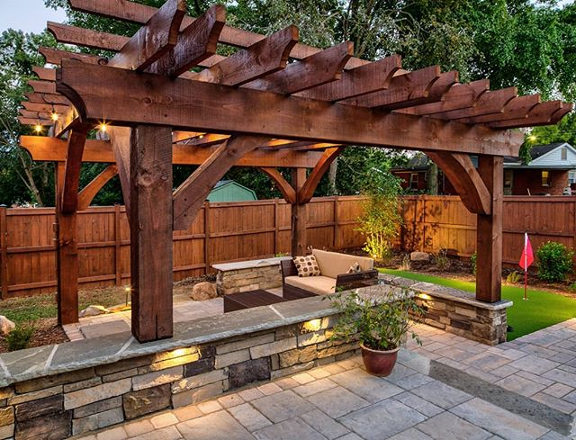 Continuing last weeks feature project to show just a few more great pics by @brucesaundersphotography. Love this pergola shot and how those outdoor lights look! . . Great design work and material choices by Josh!👌Also gotta give a shout out to Johnny's team for their craftsmanship on the masonry and hardscape. Beautiful work! 👍And that gorgeous custom pergola, built by Jason's team!👏 I am so thankful to work with such talented guys, who care to bring their best to our projects! 🤗 . . . #brucesaundersphotography #outdoorartisan #techobloc #outdoorspaces #outdoorroom #pergola #pergolas #hardscapes #hardscape #hardscaping #outdoordesign #backyardgoals #backyardbliss #homeandgarden #backyards #outdoorlivingspace #outdoordesign #landscapedesign #patio #outdoordecor #patiostyle #patiodesign  #patios #charlottedesign #charlottehomes #patiogarden #outdoorlighting #landscapelighting #pavers #designbuild