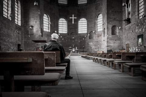 man sitting in chapel.jpg