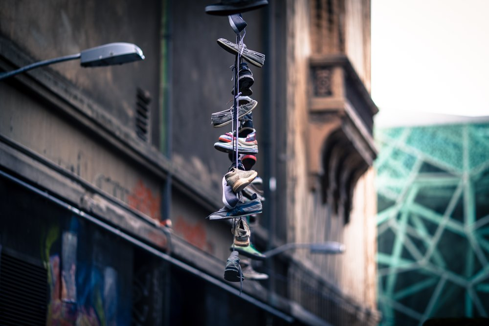 - Shoes made for traveling, are tied together on a light pole.It is an allegory for life.