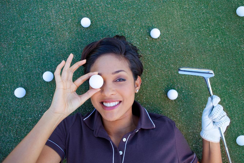 Woman_Golf_Balls.jpg