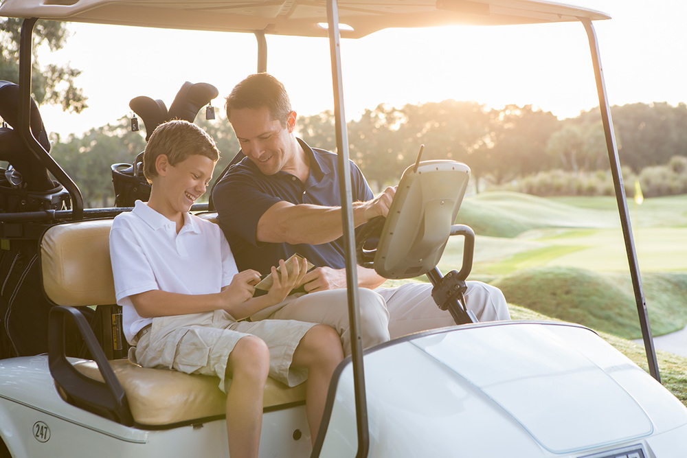 Hilton_Grand_Vacations_Father_Son_Golf_Cart.jpg
