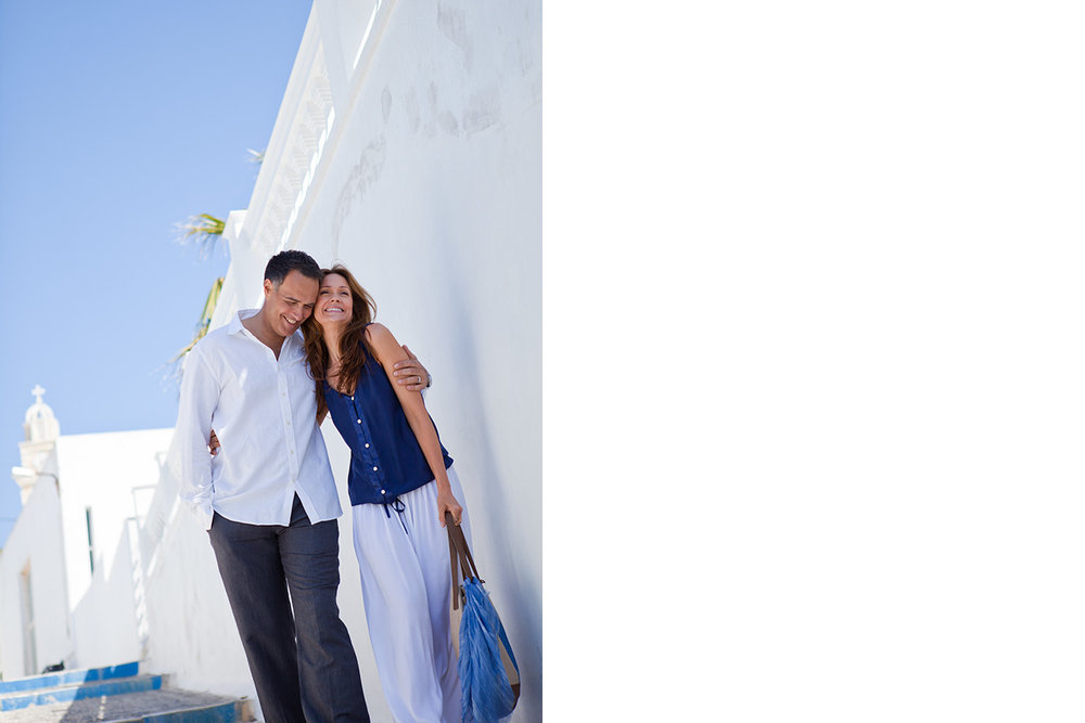 Couple_Strolling_Alley_Fira_Santorini_Greece.jpg