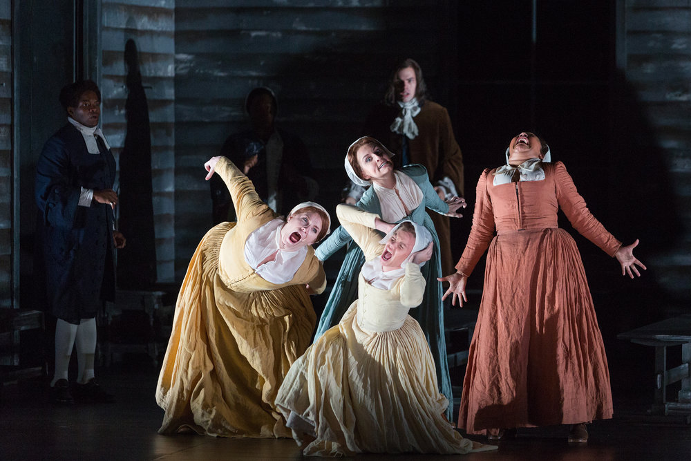 Clockwise from top: Mary Beth Nelson as Betty Parris, Ariana Wehr as Abigail Williams, Emma Grimsley as Ruth Putnam and Molly Jane Hill as Susanna Walcott in The Glimmerglass Festival's production of Robert Ward's  The Crucible .