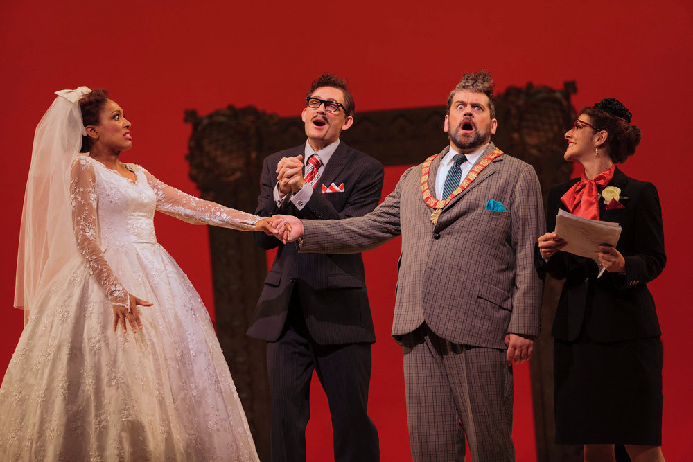 L to R: Jacqueline Echols as Giulietta, Jason Hardy as Baron Kelbar, Andrew Wilkowske as La Rocca and ensemble member Sharin Apostolou in The Glimmerglass Festival's 2013 production of Verdi's  King for a Day.