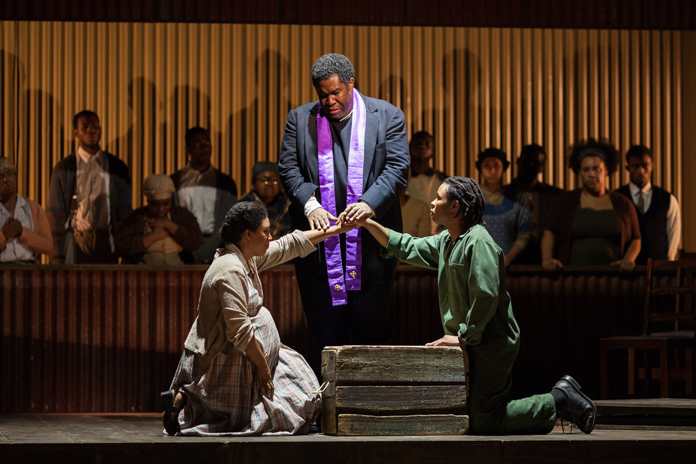L to R: Brandy Lynn Hawkins as Irina, Eric Owens as Stephen Kumalo and Makudupanyane Senaoana as Absalom in The Glimmerglass Festival's production of Kurt Weill and Maxwell Anderson's  Lost in the Stars .